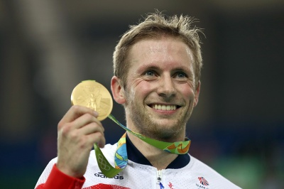 RIO DE JANEIRO, BRAZIL - AUGUST 16:  Gold medalist Jason Kenny of Great Britain celebrates during the medal ceremony after the Men's Keirin Finals race on Day 11 of the Rio 2016 Olympic Games at the Rio Olympic Velodrome on August 16, 2016 in Rio de Janeiro, Brazil.  (Photo by Bryn Lennon/Getty Images)