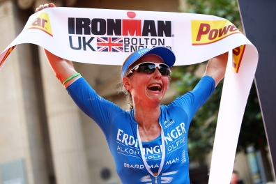 BOLTON, ENGLAND - JULY 17: Lucy Gossage of England crosses the line to finish first in the womens race during the Ironman UK on July 17, 2016 in Bolton, England. (Photo by Charlie Crowhurst/Getty Images)